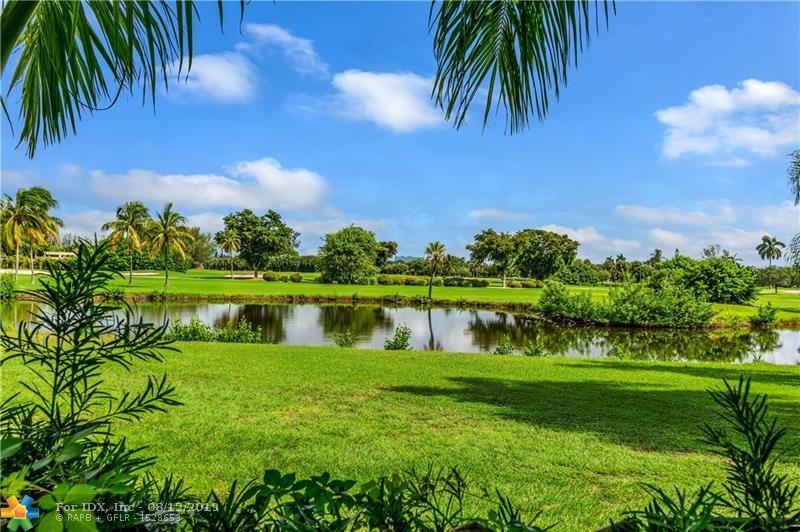 Unique opportunity to own this landmark property situated on over one acre (3 lots) totaling 49,175 sq ft of land and located on the prestigious Coral Ridge Country Club golf course. This double gated estate home offers total privacy in a park-like setting under a canopy of majestic Royal Palm trees along with your very own tennis court! The possibilties are endless, keep the current home and renovate to your taste or for a developer, subdivide and build 2 or possibly 3 new construction homes. The present home is a huge 4 bedroom/5 bath with separate gym and office, tile roof (2006), Impact glass throughout and a full house generator. Seldom do properties of this size  become available to the market.