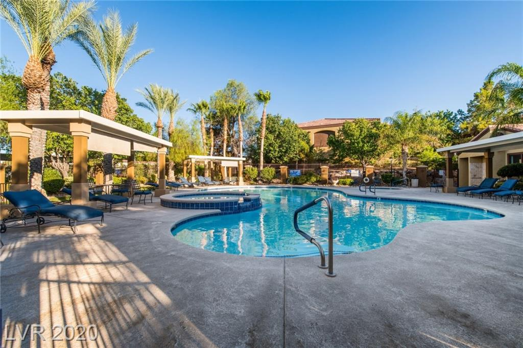 Horizons at Seven Hills Condominiums is a fantastic gated community providing quick and easy access to St. Rose Medical Center, parks, trails, dining, shopping, and recreation. Exciting Horizons lifestyle consists of sparkling pool, relaxing spa, meandering paths, and pet stations. Desirable first floor unit is ideally situated near the community pool and spa. Updated condo features many upgrades and a flexible floor plan. Kitchen opens to the living area creating a perfect environment for relaxing or entertaining. The space is highlighted with contemporary paint, dining bar, and a sliding glass door to the patio. Kitchen is treated to captivating granite counters, quality cabinetry, and luxury plank flooring. Laundry room off the kitchen offers the convenience of included washer and dryer right in the unit. Upgrades include granite, luxury plank, plush carpet, contemporary paint, and much more. Easy and helpful storage is possible via the closets and exterior storage room.