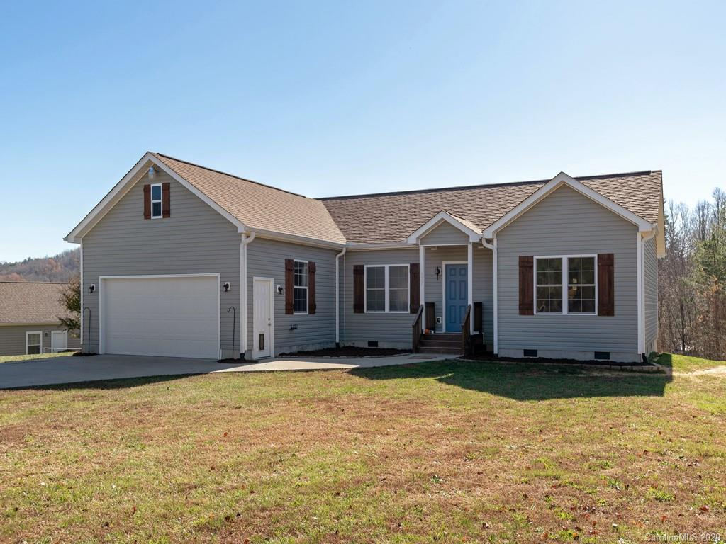 This site built home in a small subdivision provides the country-living feel while still being only minutes from Downtown Hendersonville. This home features an open floor plan which maximizes its square footage. The kitchen has a large island and a breakfast nook. The master bedroom has a walk-in closet and the master bath boasts a jetted tub and double vanity. Enjoy watching the sun dip behind the mountains from the deck that overlooks the backyard, or on those cold, winter evenings cozy up in front of the living room fireplace with your favorite beverage. Come see this one before its gone! Agent/Owner.