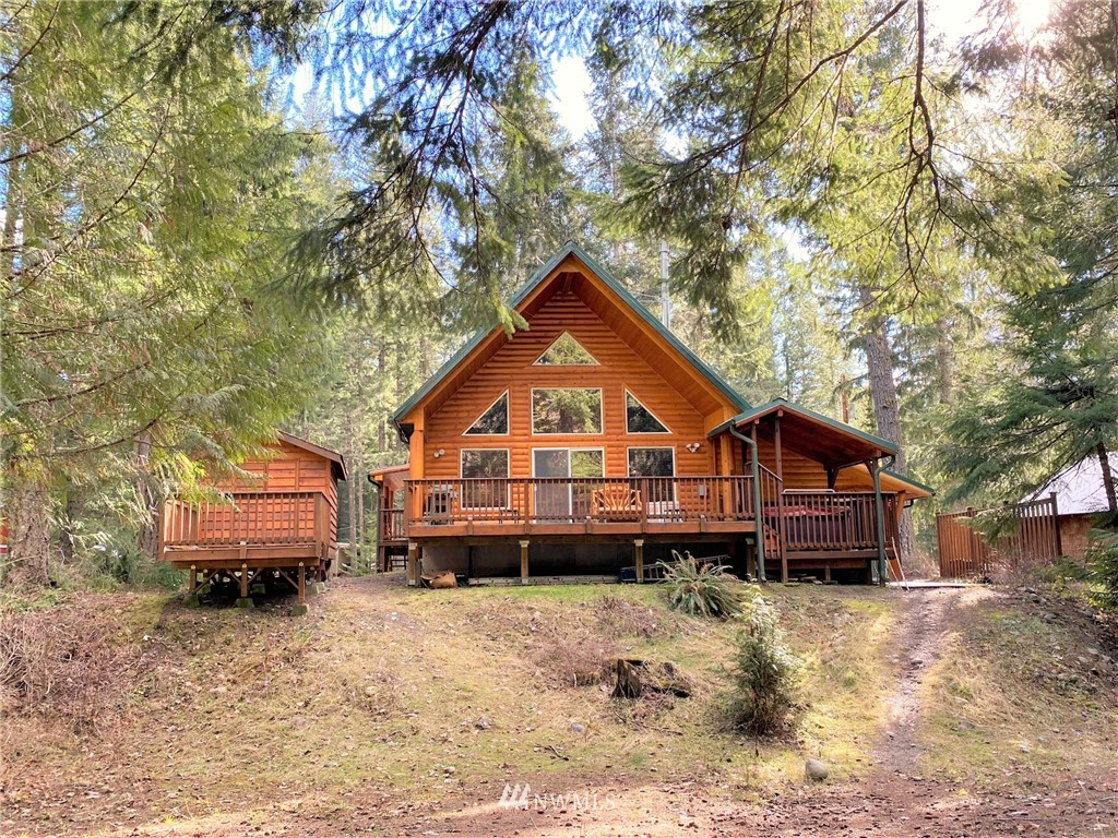 """Exceptional craftsman log retreat in Packwood WA. Offered turn key! All appliances, and furniture stay with home. Strong vacation rental history. Located in desirable Timberline community with Cowlitz river frontage. Access to HOA amenities. Pool, playground, tennis. This home features 3 Bedrooms/2 bathrooms + the """"Stargazer"""" suite/studio with 3/4 bath. High quality custom wood finishes, propane standing stove, hot tub, large deck space, shed. Lots of space for relaxing or entertaining. Less than 25 minutes to White Pass skiing & Mt Rainier Natl Park. 2 1/2 hours to SEA & PDX . The location is perfect for anyone who likes to hike, fish, boat, ski, snowshoe, or just relax in nature. Elk, eagles, and salmon are a common sight at the cabin."""