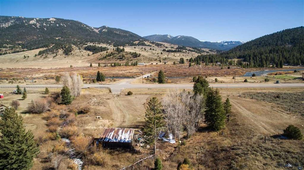 Located across from the Gallatin River with close proximity to the Big Sky school district & Porcupine Preserve trail head.  This lot is not associated with a subdivision, the lot is encumbered by Gallatin County building regulations only.  The building site your home & can include a possible guest apartment, detached garage if desired, and possible short term rental. Just minutes from Big Sky Resort with views of Porcupine Preserve, a winter habitat for the elk herd. Close to snowmobile, atv, trail heads.
