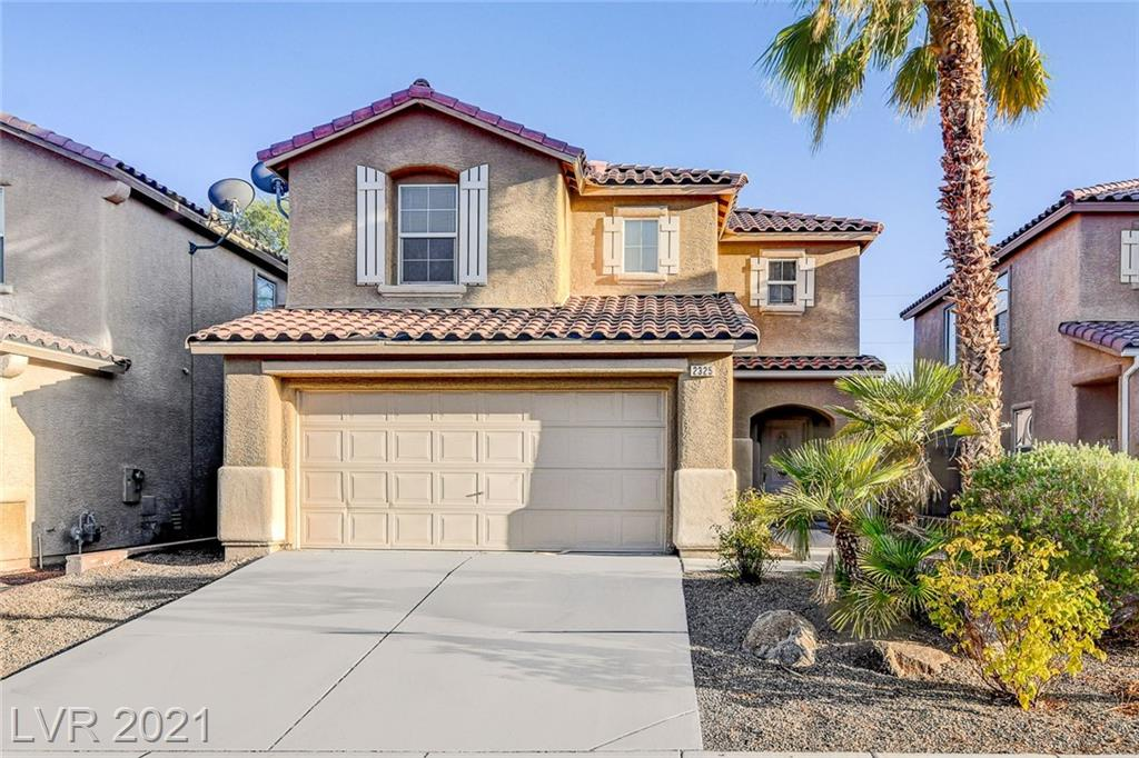 Gorgeous two story home in beautiful Aliante Master Planned Community!...Huge kitchen with tons of storage and breakfast bar. Large backyard with covered patio and dessert land scaping.
