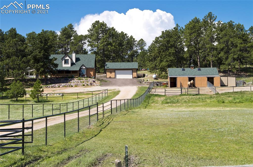 You won't be disappointed in this beautiful log home!Immaculately kept, nested in the pines with beautiful views to the east!Coffee and Cocktails are beckoning you to enjoy on the 10x24 covered front porch! Bathrooms and Kitchen have been beautifully upgraded; Kitchen includes *Solid Surface Countertops*Stainless Steel Appliances*An Abundance of Cabinets and Counter Space*2 Kitchen Sinks*Ceramic Tile Floors. Convenient Laundry Room and Mud Room on Main Level* New Acacia/Asian Walnut Wood floors on Main Level* 3 stall Barn
