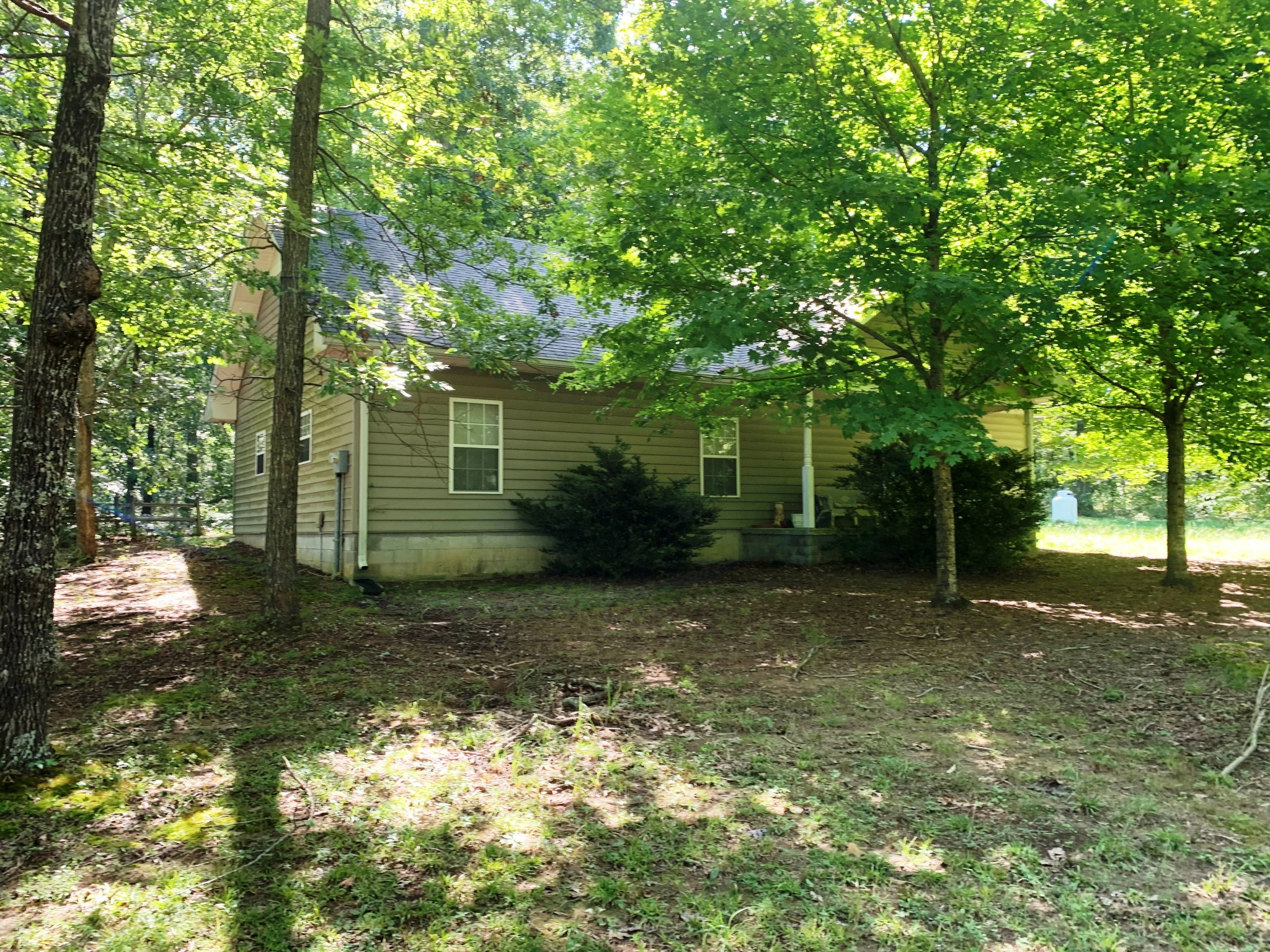 "Shop home and 9.94 acres ~ 40x31 Shop w/2 garage doors,1 bedroom, 1 bath, kitchen, living room & concrete & tile flooring ~ Shop is set up for woodworking with ""in-floor"" vac system ~ Some marketable timber ~ Lots of widlife ! Located just 3 miles off of Highway 96 and I-40 Exit 182 ~ Williamson County schools ~ Great area with lots of nice homes nearby!"