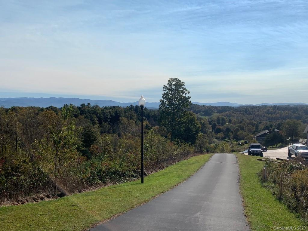 This Beautiful building lot in Red Oak Plantation located just 20 minutes to downtown Asheville. Red Oak Plantation  is a lovely neighborhood featuring great mountain views, paved roads, street lights, and underground utilities.  There are minimum restrictions and covenants that insure high property values in the future.  1500 minimum build, stick built homes, well and septic required. One of the best views in the neighborhood. Fall in love with this quiet neighborhood of upscale homes and build the home of your dreams.
