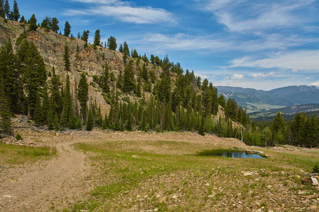 Living big is easy at the Big EZ Estates.  Available for sale individually or together, these lots offer spectacular views of the surrounding mountains. The properties are highlighted by elevated plateaus, water features, trails, and southern exposure. Enjoy wildlife, peace and quiet with close proximity to Big Sky.
