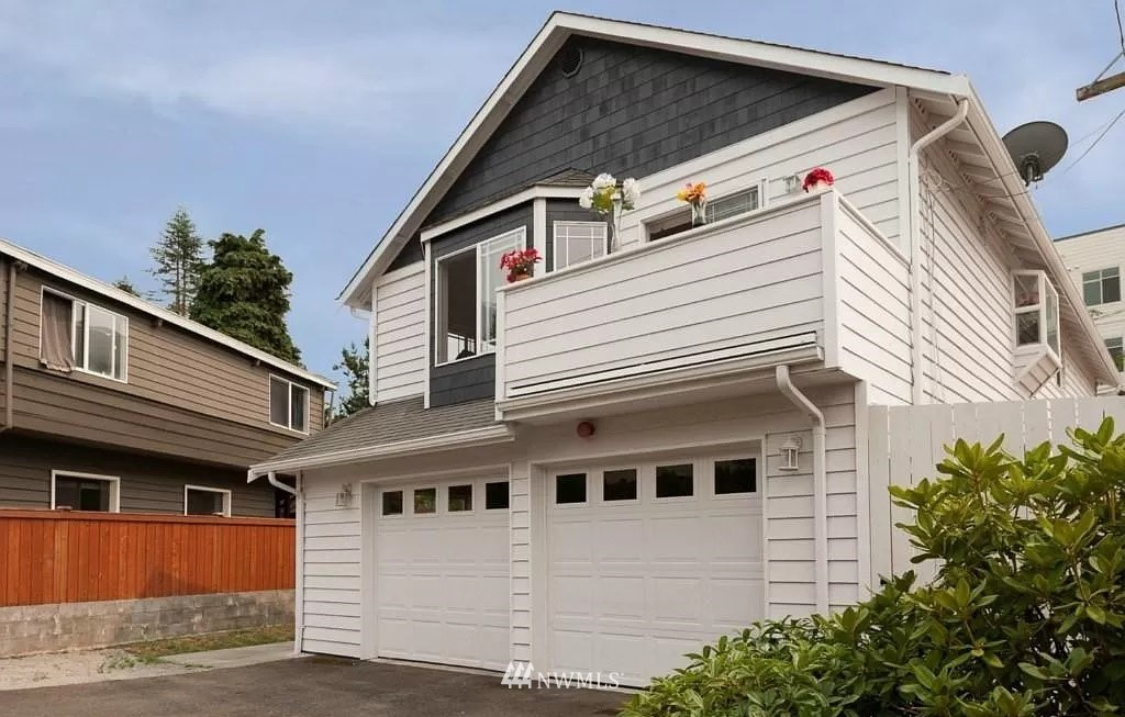 Built in 2000 w/ Certified ADU, permitted for 2 separate parties. Both units have a separate entrance. Total 5 bdrms/3 baths, 2 kitchens, 2 living rooms, 2 dining rooms, 2 separate yards & BBQ deck. Huge yard, fully fenced. 2 car garage w/ W/D & 3 more parking spaces. Abundant light in all rooms. Unit A has new SS appliances, new carpet & paint. Unit B has new plumbing and a gas FP. Live in 1 unit & rent the other to reduce your mortgage payment substantially. Award winning Shoreline schools.