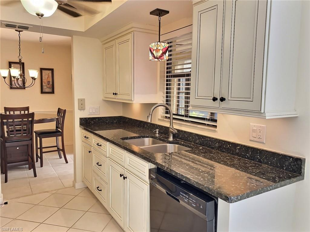 Gorgeous, partially furnished 2 bedroom / living Room / dining / kitchen / den /office / 2 bath condo-over 1000 sq ft with screened in tiled lanai overlooking a preserve view. The lanai has Florida windows to shut away the rain or chill. This condo has new HVAC including parts warranty, new appliances, kitchen and bath-all updated with new cabinetry & granite countertops. All new ceiling fans to enable the most efficient use of the HVAC when needed.  Deeded carport and exterior locked storage with unit. The Club offers beautiful tropical landscaping throughout the community with activities for everyone!  Two heated pools with jacuzzi's and saunas.  Lighted tennis courts, fishing pier, walking and jogging trail around the Lake.  Lakes park is just a short walk or bike ride away.  Enjoy gatherings at the clubhouse, there is a very active social committee with a Facebook page to share all the sponsored events.  Just do an internet search for Crystal Clear News at the Club.  No need to have a Facebook account to browse.