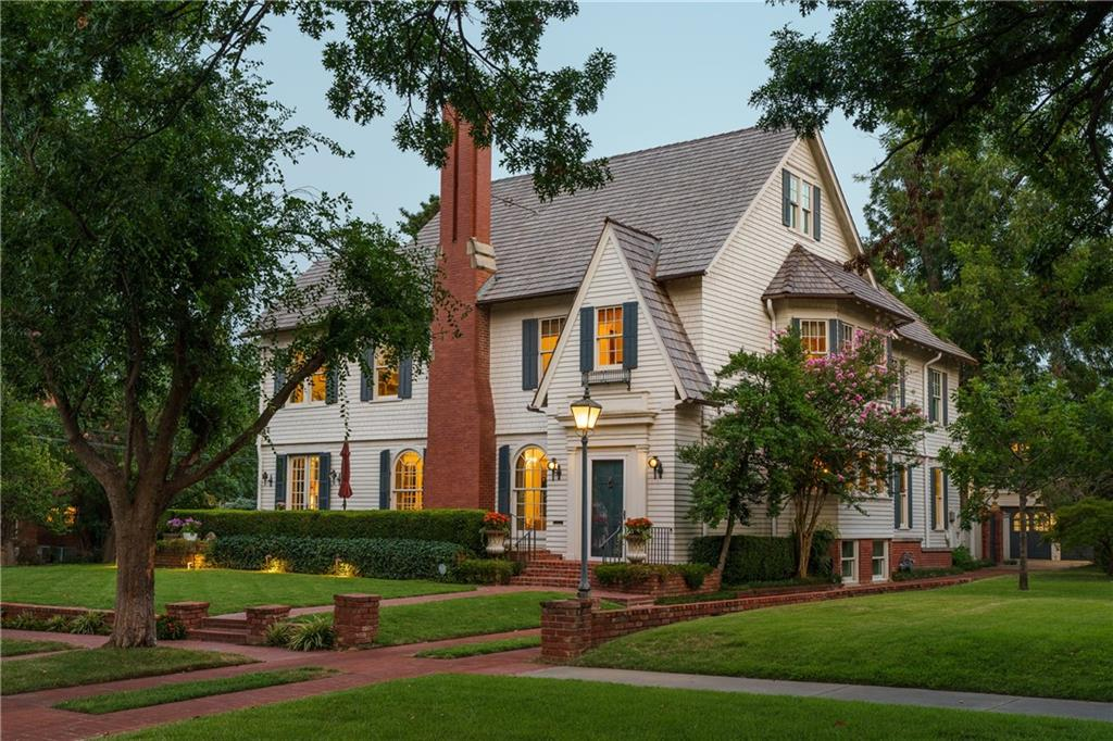 Majesty and splendor in Heritage Hills. The history of this 1906 home is the history of OKC. Lovingly tended to by the five families who have called it home, this is a generational home with an easy elegance and it awaits its next chapter. The main residence is three stories, restored and renovated with meticulous attention to historic detail. The original door knocker welcomes into a pretty foyer, beyond which is living, dining, library, kitchen, morning room and large den. Elegant arched doors, original and restored hardwoods and molding, pocket doors. Eight mantels throughout including a circa 1840 Biedermeier. Four bedrooms including the glorious primary suite on the second floor. Up one level is a theater quality screening room, large studio and children's performance stage. Huge three-car garage with apartment above with full kitchen, bedroom and ensuite bath that is included in marketed square footage. Corner lot with elegant landscape brick sidewalks. A truly rare opportunity.