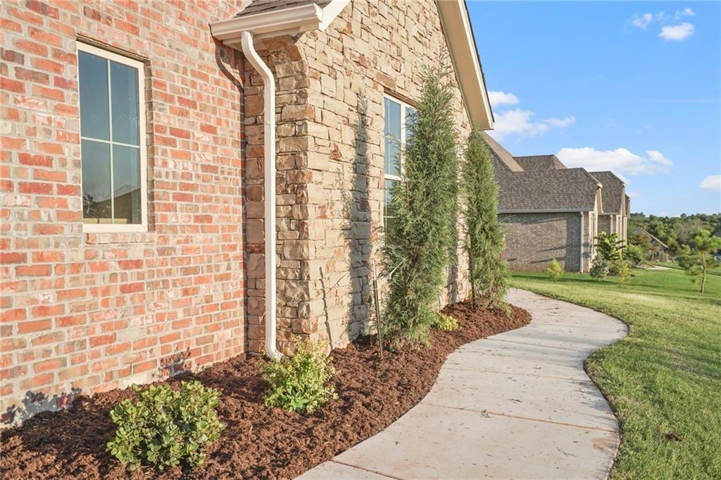 WOW! Looking for 3 true bedrooms, PLUS study with closet/4th bedroom, PLUS bonus/game room and open island kitchen/living/dining all on one level in Mustang schools? This is it! Stunning finishes, fantastic floorplan, on-trend decor; all on over a half acre with access to FAA, South OKC, downtown, I-44, Will Rogers Airport and more! Beautiful open kitchen loaded with granite and stainless features custom cabinets, pantry and island seating. Living room boasts cathedral ceiling and cozy brick fireplace. Luxurious master suite with double sinks, tile shower, seperate tub and walk-in closet connects with room utility area. Large patio, all on over a half acre. This one has it all!