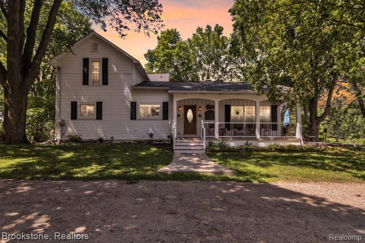 Fall back in time in this Beautiful Historic Farm House in a peaceful country setting, yet close to shopping, restaurants and freeways. This grand estate features a large front porch and back patio where you can Gaze over the 40 acres of rolling fields, ponds and woods. Enjoy the many updates including new roof in 2016 additional blown in insulation, new furnace and hot water heater 2018 , Kitchen and bath remodeled 2019 and new windows in 2020.  40 x 60 Pole barn including 4 stalls for horses and live stock, work bench with shelving and tons of storage, 2 car parking spaces with automatic garage doors.  Small out building, could be used as a garden shed or added storage. There is plenty of room to roam in nature, rolling fields and woods, or fish in one of the ponds on this beautiful land.  This is a hunters dream land filled with deer, ducks and geese.   All this close to Historic downtown Holly and the Holly Hotel, the Michigan Renaissance Festival, and top rated schools.