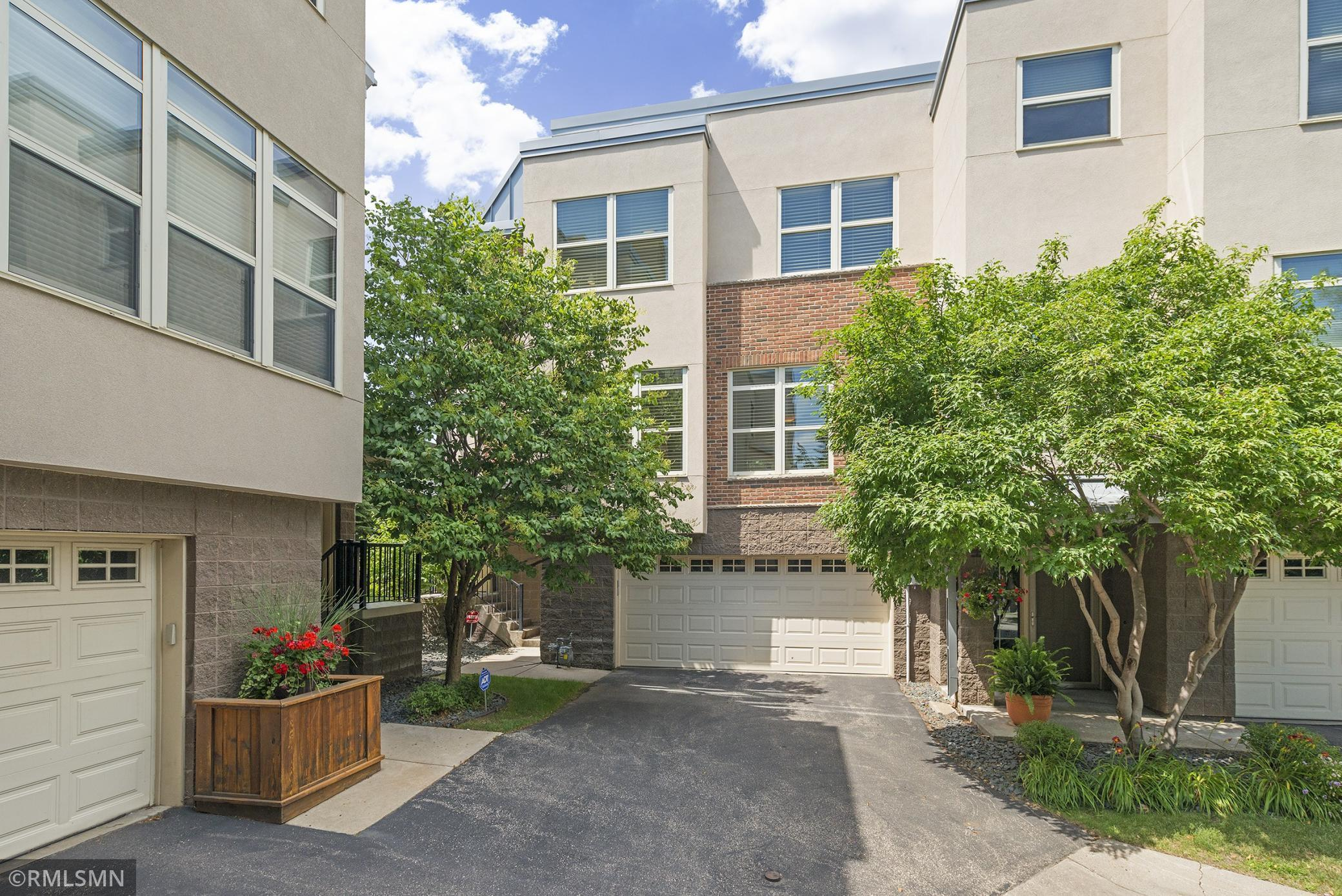 This spacious & sunny end-unit townhome is located in the most private corner of Village Townhomes.  It is one of the corner units with the largest floor plans in this community and features plenty of space for work-from-home AND home gym.   Enjoy a private backyard balcony, 9 ft ceilings, tons of windows, and the convenient 2-car garage.  The upper-level loft can easily be converted to a 4th bedroom.   Walk to everything in this European-style walking neighborhood just across from downtown and surrounded by parks, the riverfront, shops, restaurants, and historic charm.