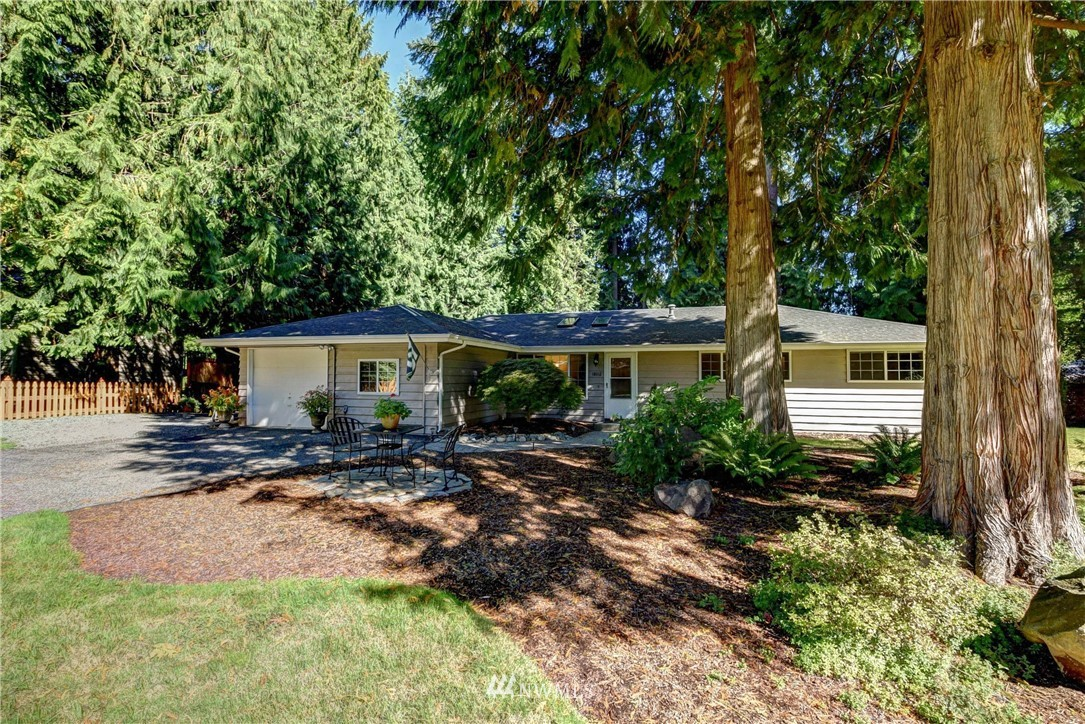 """Quiet, Private Cottage Lake Area RAMBLER with a Stunning Backyard Oasis ~ Excellent 1,610, asf 3 Bed + Office, 1.75 Bth home w/""""smart spaces"""": Bright living room w/skylights offers a quiet retreat, family room w/slider to outside, separate office w/closet for a dedicated work-at-home space. 5-Star entertainer's outdoor paradise: patio, water fountain, colorful plantings. Oversized util. room for your sports gear, dog washing & crafting! Excellent schools, nearby trails, shopping & Wine Country!"""