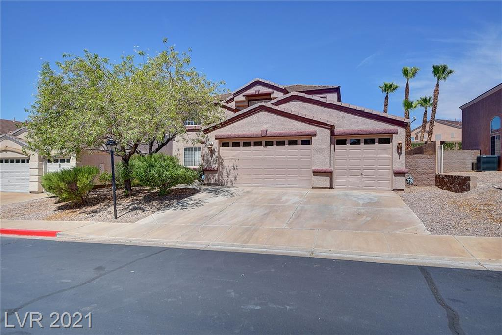 Beautiful home located in the Black Mountain Vista community. This home offers ample space and a highly sought after dual master. Home  offers 7 bedrooms and 4 and half baths, two living rooms, a master bedroom downstairs and a spacious kitchen. Back yard boasts an L-shaped pool and various fruit trees