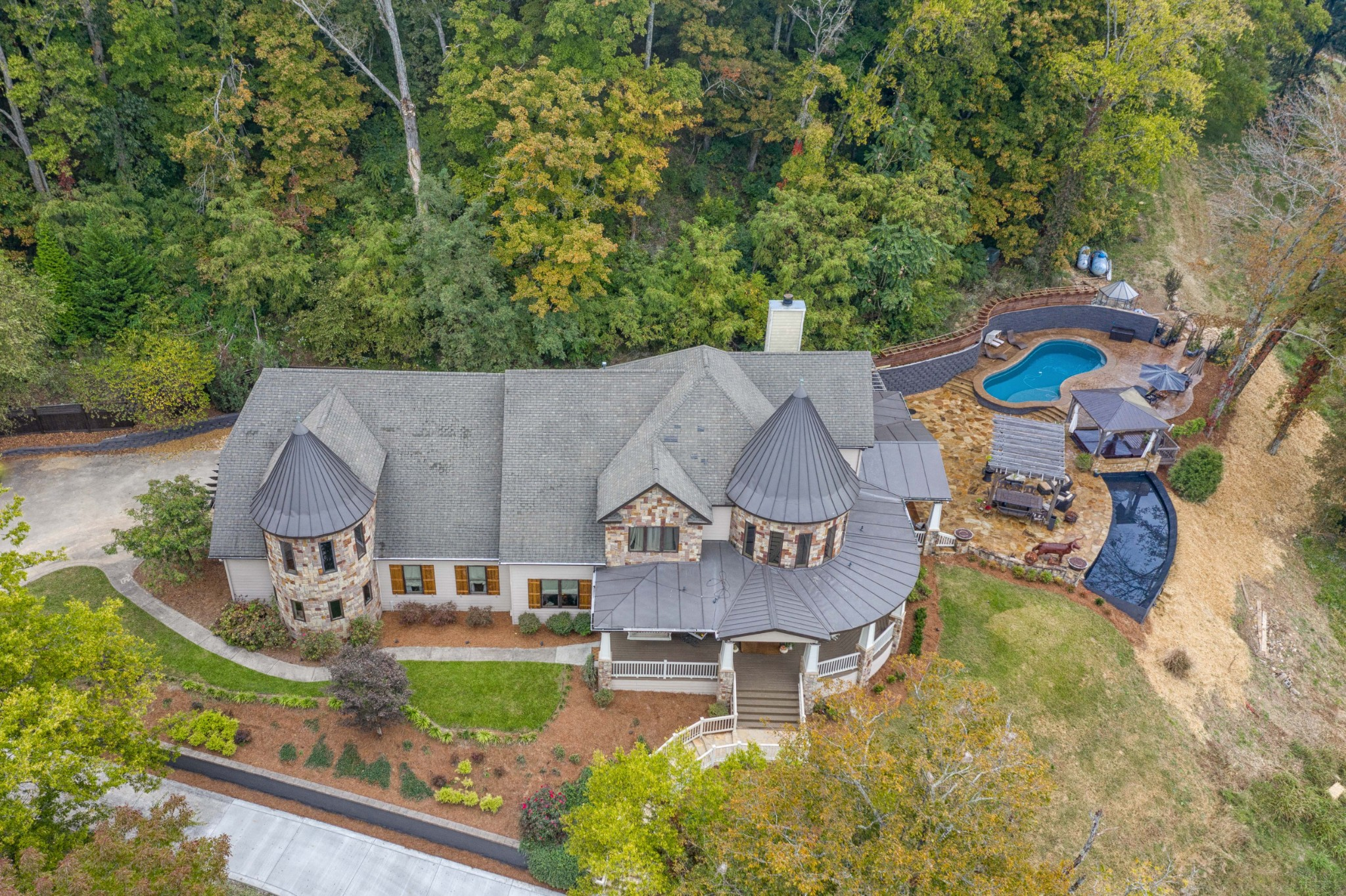 Custom country dream home!Enjoy the morning mist as it rolls across the hills w/10mile views from a 1500sqft wraparound porches overlooking 17acres ready for horses &livestock.Stunning entrance w/curved staircase; 4beds 4baths,chefs kitchen,1400sqft theater/game room.Entertain in a designer outdoor living space w/heated saltwater pool, covered hot tub & infinity edge water feature,outdoor kitchen w/fireplace&bar.52'x 90' tobacco barn w/concrete floor, 5horse stalls &workshop. Cozy cabin w/pond.