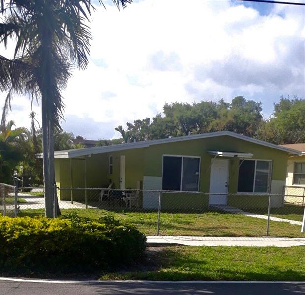 Lovely home in a family neighborhood with spacious fenced in garden with plenty of room to build a pool. This  home is equipped with hurricane impact windows and doors. New stove will be installed. Minutes, to the airport, the beach and the restaurants makes this place a good location. There is no HOA . SHOWINGS START ON TUESDAY, MARCH 9TH