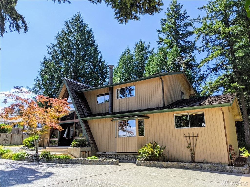 Beautifully handcrafted chalet-style A-frame with artistic details: spiral staircase, stained glass, hand-split cedar shakes, pump operated moat. Over-sized detached garage with lofted space for office or possible ADU, and a basketball hoop! Gorgeous Cascade mountain views to the east on .56 acre lot on the top of Sammamish. Lake Washington School District. Public sewer is stubbed nearby for easy conversion. Quiet, friendly neighborhood. Excellent opportunity to buy into the Sammamish community.