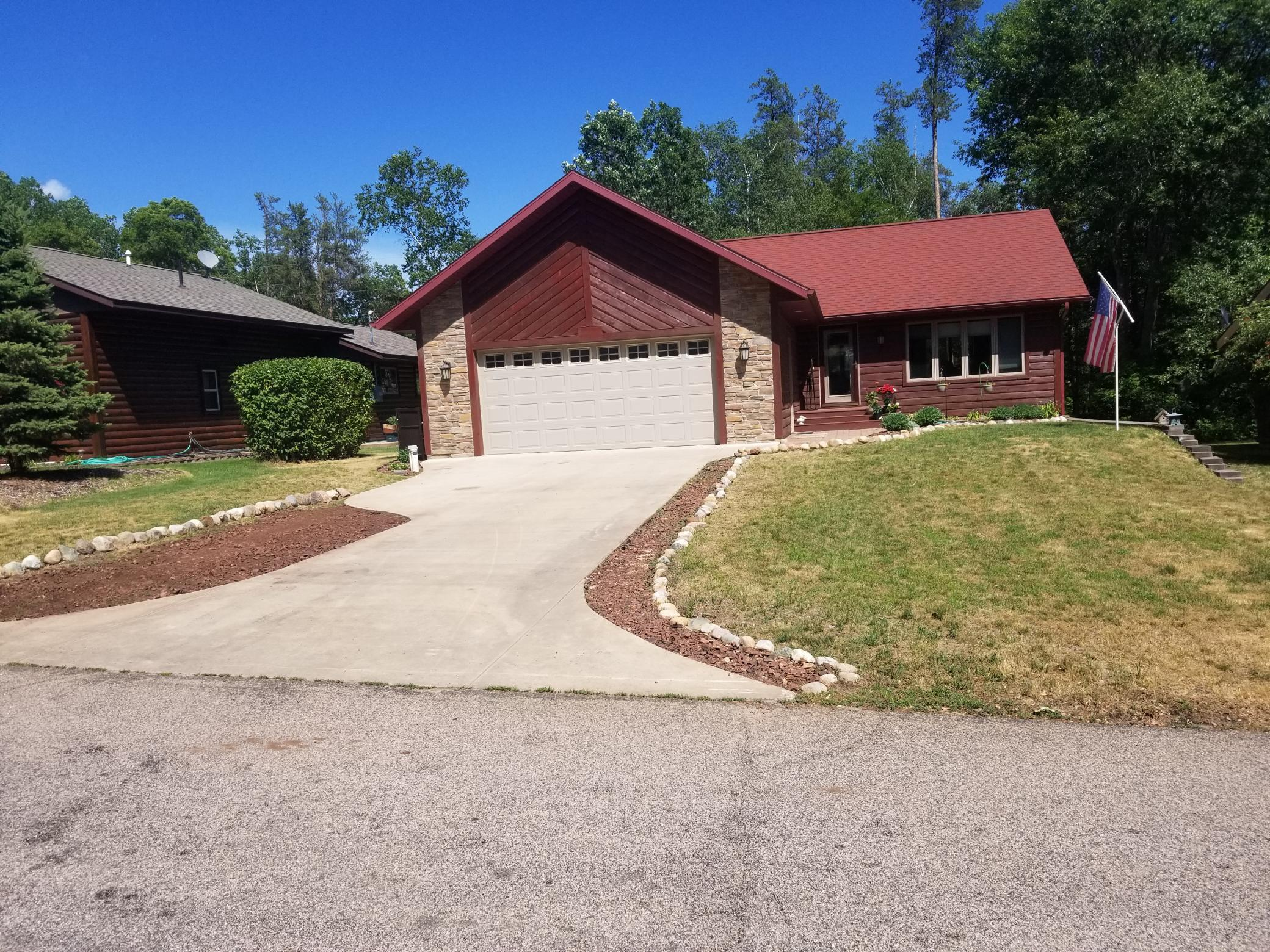 Beautiful and well maintained home just through the gates of Breezy Point Resort. Come live in the lake country!