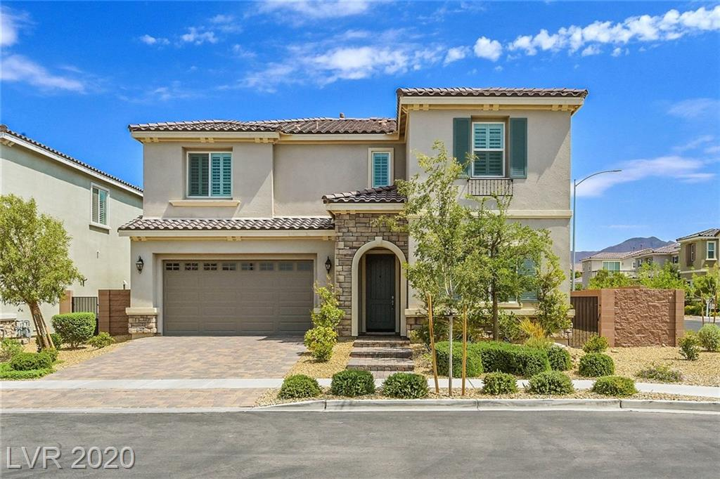 Beautiful 5 bedroom home with pool!  This home features a bright and open floorplan, hardwood flooring on the 1st floor, upgraded carpet in bedrooms, and ceramic tile in bathrooms.  The gorgeous kitchen features quartz countertops, stainless appliances, gas cooktop with hood, walk-in pantry, spacious breakfast/dining area.  Kitchen island is equipped with wine refrigerator.  The great room has triple sliding doors offering views of the pool in back and surround sound.  The master bedroom suite boasts 2 walk-in closets, dual sinks, bathtub, large shower, and balcony.  The loft is spacious and has built-in cabinets.   Awesome backyard with swimming pool, covered patio with pavers, and synthetic grass.  Great Inspirada location, with access to both Inspirada AND Toll Brothers community amenities!