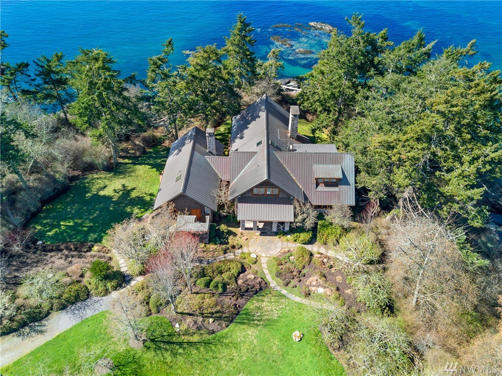 Perfect San Juan Island Westside Estate! Beautifully built w/custom materials and finishes throughout. Unique handmade hardware & metalwork, reclaimed heartwood lumber and Montana river stone. 3 beds , 4 baths, granite counters, stressed wood floors, giant stone fireplace, & large dramatic windows. Includes outdoor Murphy bed, stone fireplace, fire pit at deck's edge, patio, & sculpted plank siding. 18 +/- acres of quiet & privacy, 2 accessible beaches, fenced orchard & garden in all day sun.