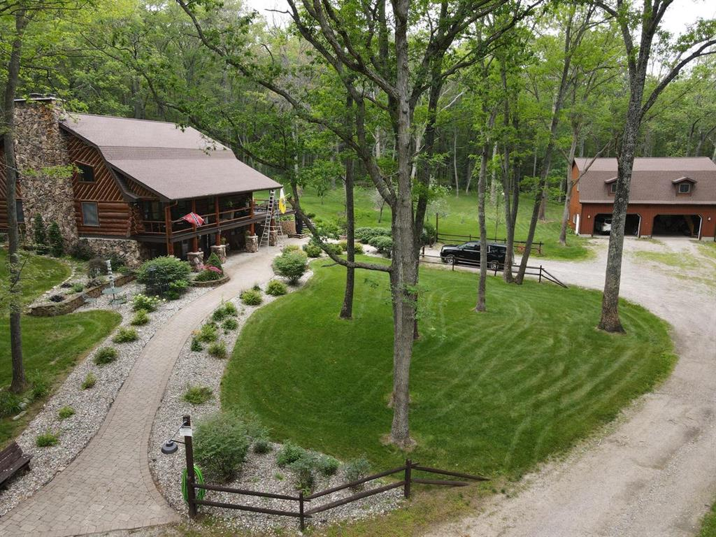 If viewing on Zillow call listing agent directly. Custom built full log home located on a private drive about 7 miles North of West Branch. This stunning 4 bed , 3.5 bath features a large open kitchen and living room floor plan with wood burning fireplace. The full walk out basement also features a wood stove along with a custom built bar and a full kitchen. Enjoy a peaceful view from the large covered porch that overlooks the beautiful yard and landscaping. The 2400 garage is 26 construction with a massive upstairs and is attached to a 30 x 40pole barn. No shortage of storage here. The fully wooded 13 +/- acres backs up to several hundred acres of state land and only a short distance from Clear Lake and the famed Ogemaw Hills trail system and provides endless recreational possibilities., 3.5 bath features a large open kitchen and living room floor plan with wood burning fireplace. The full walk out basement also features a wood stove along with a custom built bar and a full kitchen. E