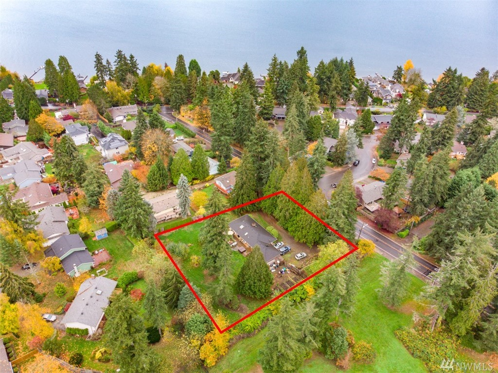 Attention developers! Here is a rare 33,450 sf lot zoned R4. Great location plus great schools equals a fantastic opportunity. The home has 4 bedrooms, 2 baths and an updated kitchen.  Home is cozy and could be lived-in while the plans are being developed.