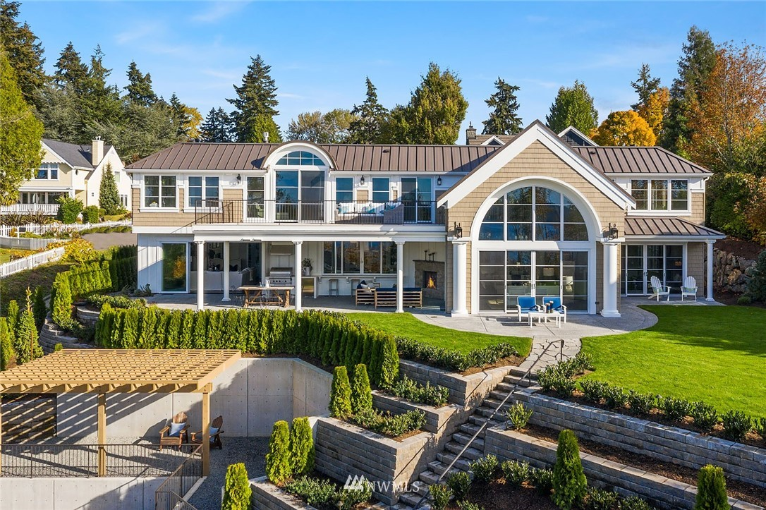 A seamless blend of elegance, comfort and livability defines this brand new Hamptons-inspired view estate. Soak in the big western views of the lake, Seattle skyline and Olympic Mountains. Imagine the possibilities with the shared dock, the integrated indoor and outdoor living spaces, and a detached guest house (or home office) with heated 2-car garage/flex space. The main house features a flexible floor plan with dramatic 19' ceilings, a 2nd master/den-office on the 1st floor, a bonus room with kitchenette/wet bar, a climate controlled wine room, a 2nd study/office, manicured grounds and a multi-use Sport Court. All the flexibility you need to create the lifestyle you've imagined. And all in the heart of Medina!
