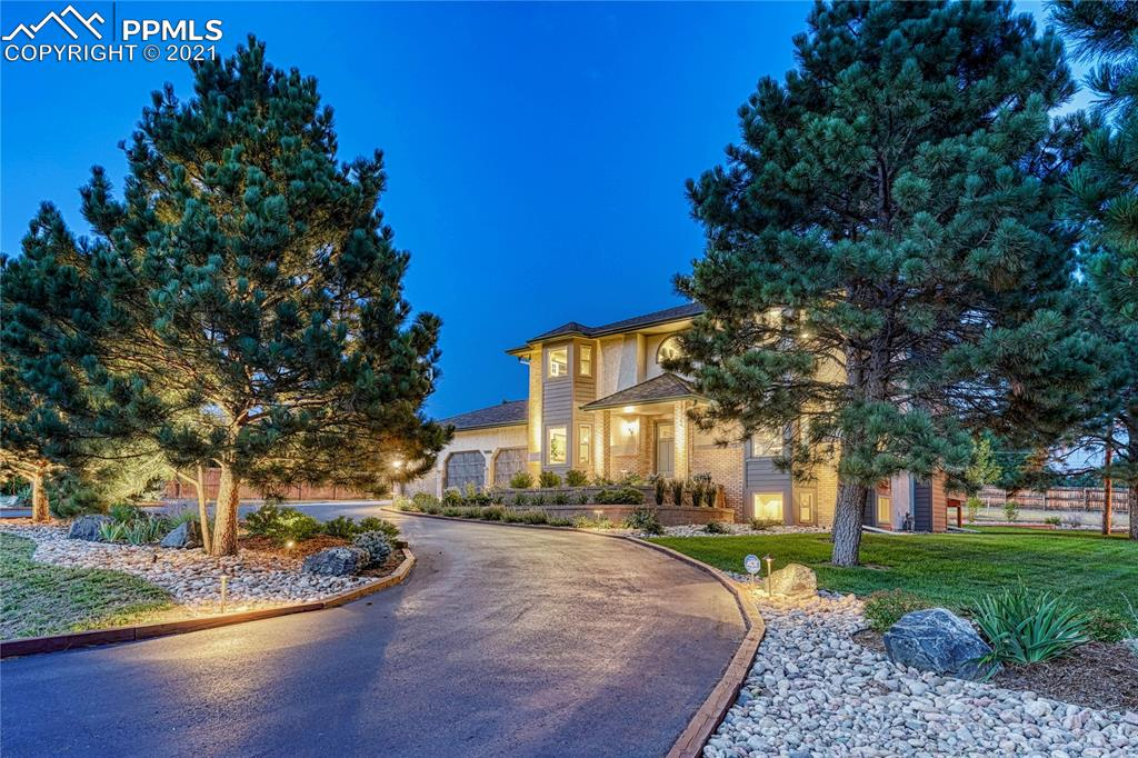 RARE OPPORTUNITY! Impeccably maintained, 4BD 4BA 9CAR home w/luxury finishes, Pike's Peak views, finished basement & detached 44' x 36' RV garage ON AN ACRE in the middle of the city!! This home in the highly desirable Academy School District #20 offers 3,998 sq ft & is professionally landscaped. High-end details include rich knotty alder doors & trim, gorgeous wood floors, custom tile work, upgraded light fixtures, 9' ceilings on main, beautiful open staircase & outdoor fire pit…kitchen refrigerator and hot tub included! The eat-in kitchen has a gas range, quartz countertops, tile backsplash, pantry, bay of windows, breakfast bar & message center. The adjacent great room boasts a gas fireplace, custom tile surround, custom-built cabinetry & walk-out to a 26'x16 deck. The formal dining & living rooms feature a bay of windows w/stunning Pike's Peak views. The main level laundry offers luxury vinyl flooring, cabinetry & garage access. Upstairs are three of the four bedrooms, including a spacious primary bedroom retreat w/Pike's Peak views, hardwood floors, ceiling fan & upgraded fixtures. The adjoining spa-like bath has a stand-alone tub, zero-entry shower, custom tile work, upgraded fixtures, custom cabinetry & walk-in closet w/window. One of the additional upstairs bedrooms offers an incredible Pike's Peak view. The other adjoins a full bath featuring wood-look tile floor, quartz countertop & upgraded lighting. Both bedrooms also have hardwood floors, ceiling fans & walk-in closets. The basement boasts a family room w/a gas fireplace, surround sound & a wet bar and a game/rec room w/above-grade windows & Pike's Peak view. Rounding out the basement is a home office, bedroom w/walk-in closet & ceiling fan & a ¾ bath w/his & hers vanities. The finished, detached RV garage has both a 13 ½' and a 10' door, ceiling fans, heat and 220-volt. Its convenient location is just minutes from I-25 and Powers Boulevard & offers convenient access to shopping, dining & entertainment.