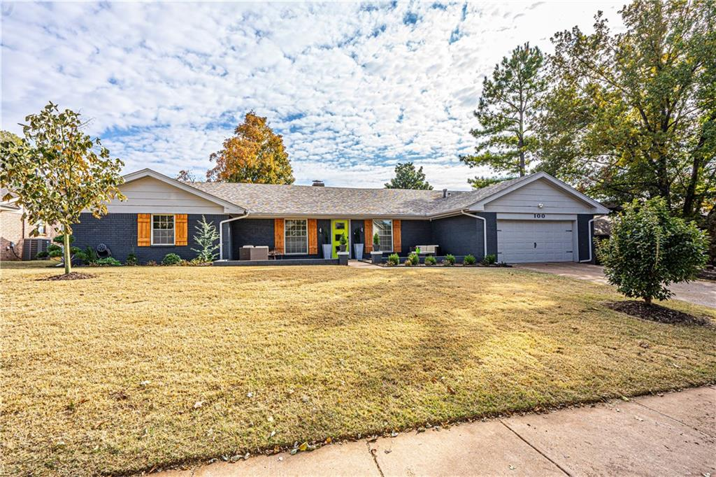 Home buying can be hard, make it EASY with this 3 bedroom 2 and a 1/2 bath home with impressive modern style! Open floor plan is perfect for entertaining. Large open concept with stunning floor to ceiling modern brick fireplace. Kitchen is perfect gathering spot for family and friends with its granite center island and adjacent sunlit breakfast area with built in bench seating with storage. Overlook the beautiful POOL and backyard from the kitchen and living area. Serene master retreat boast 3 closets, walk in shower, dbl vanities with quartz counters.  This home has a wonderful layout and features a wet bar, central vacuum, fire rock fireplace, granite, quartz, wood floor tile throughout and much more. All this and a wonderful location convenient to shopping and schools. Neighborhood has community pool, tennis courts, and park.  Welcome Home...Welcome to EASY STREET.