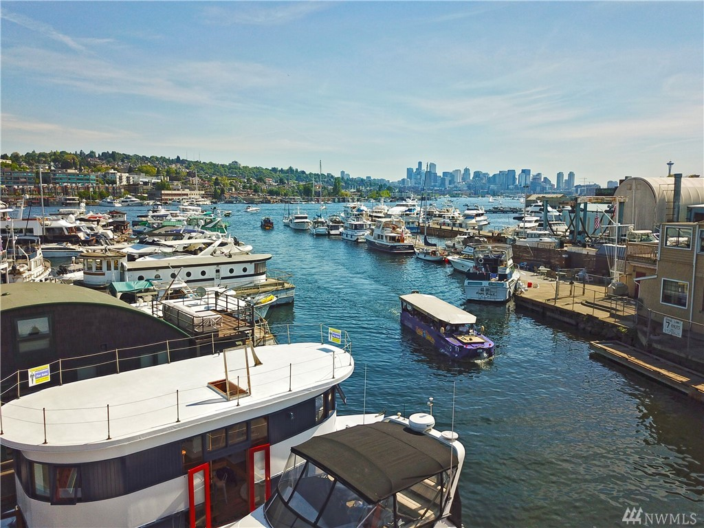 Enjoy life at a different pace in this beautifully restored Houseboat, Slip rent $769 pm & includes water, garbage & livaaboard. Andante has 2 bedrooms, master Stateroom with En-Suite 3/4 bath, remodeled Kitchen w/Corian countertop & stainless appliances, wrapped in windows w/Lake Union views. Large Rooftop deck w/amazing Lake & City views.  Built-in Dinette, Office, Washer-Dryer, Electric Fireplace, Updated lighting, Oak Hardwood, Carpet & Tile floors. WOW!!! Recent haul-out & inspection done.