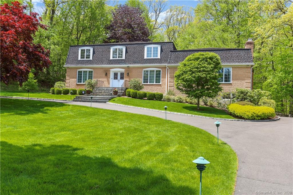 Elegant Colonial located at end of one of Stamford's most desirable cul-de-sacs giving this home wonderful convenience while enjoying the privacy & serenity of southern N Stamford. Gracious Foyer with grand circular staircase & radiant heated marble floor welcome you. Main level living offers wonderful space including Living Room; Dining Room; fabulous Eat-In Kitchen with granite counters & butcher block topped center island affording tons of storage incl the walk-in pantry, 6 burner Dacor range, stainless appliances plus 2 refrigerator drawers & separate work sink all opens to the Breakfast Area with 2 sliders leading to the stone patio & on to the open Family Room w/stone-walled Fireplace. Add in the generous Playroom w/Fireplace, Laundry, 1st floor Bedroom & Full Bath and you'll realize everything you're looking for is right here! Upstairs showcases the Master Bedroom with Sitting Room overlooking private yard & featuring a cozy Fireplace, built-ins and closet, plus Walk-In Closet & marble Master Bath w/claw footed tub & separate shower. Three additional spacious Bedrooms & Full Hall Bath with double vanity. The lower level, has epoxied floors & loads of room for whatever you can imagine + an additional room with the 4th Fireplace & exterior access. Hardwood throughout, automatic generator, irrigation system, new windows & sliders, hardy plank exterior - and the list of updates & features goes on. Private setting with lovely yard for hours of outdoor enjoyment!