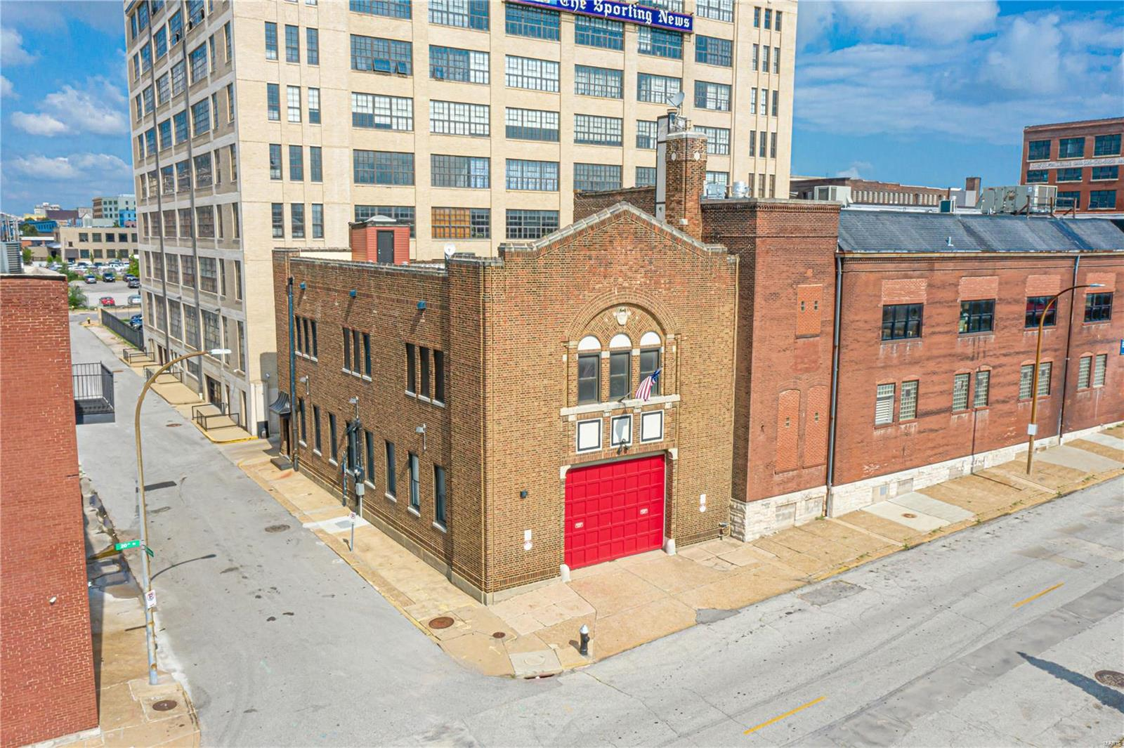 """Located just two blocks from the new MLS Soccer stadium is this rare and unique opportunity to buy a signature property - Engine House No. 32 built in 1919. The potential for this building on the National Registry of Historic Places is endless: restaurant/bar, creative workspace, gallery, or a live/work residence. Currently, the main level is used as a gallery and storage space with a parking garage. The 2nd level loft features an expansive, open living area with 15' ceilings, dramatic skylights, original yellow pine floors, fireplace & gallery lighting. 2 bedrooms, and 2 full baths. The kitchen is equipped with a center island, gas range, and white double-height cabinets. An open office/library with a spiral staircase takes you to the rooftop for panoramic views of the city.  Located adjacent to Brick River Cider on Washington Avenue & close to The Schlafly Tap Room, Fields Food and much more. Zoned """"I"""", which includes commercial, but no walkup window or drive-throughs."""