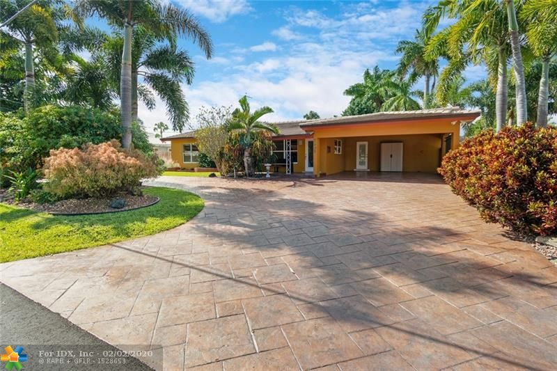Welcome to this 3 bed,2 bath oasis situated on one of the largest corner lots in eastern Oakland Park,bordering Wilton Manors and Ft. Lauderdale This property features a custom-designed pool with beach shelf, mini waterfalls pool heater  2017 The back and side yards are surrounded by a wall for maximum privacy. A mid-century modern gem, the house impresses with sparkling, original terrazzo .The master bedroom has an ELFA closet system and ensuite bathroom with an industrial rolling shower door Additional features include: flat tile roof 2017, central AC 2018, large laundry w/ 2019 programmable washer/dryer There is a 2 car carport and room for 8 cars Located a mile from the BEACH this tropical retreat can be your amazing home or vacation rental opportunity!