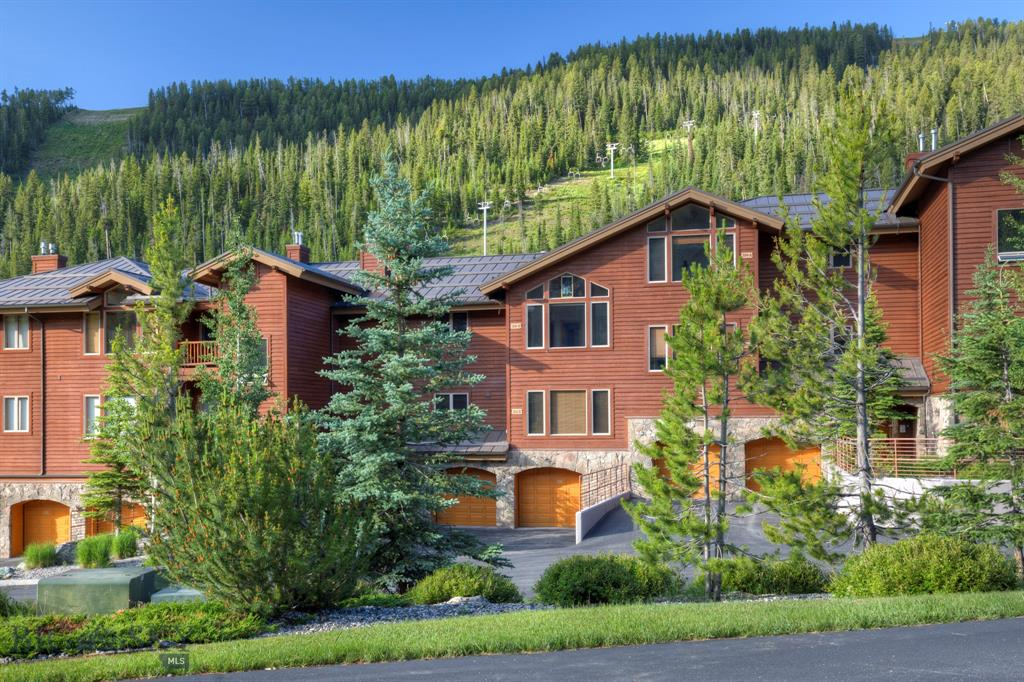 This fabulous ski in ski out condo is nestled into the trees in Lone Moose Meadows, south facing and overlooking the ski runs of Big Sky Resort and the Middlefork of the Gallatin River.  Located half way between Big Sky Resort and Big Sky Town Center this condo is at base of Lone Moose Chairlift which connects to the Thunder Wolf Lift on Andesite Mountain.  This dream condo is single level living on the upper level, 2 bedrooms with en suites,  an open floorplan, 2 propane fireplaces, elevator access, private storage closet, 2 car tandem ADA garage (6ft larger), plus access to a fitness facility and hot tub on the property.  1 bedroom apartments is also available for rent through the HOA.  This condo to be sold furnished, minus artwork and personal items.