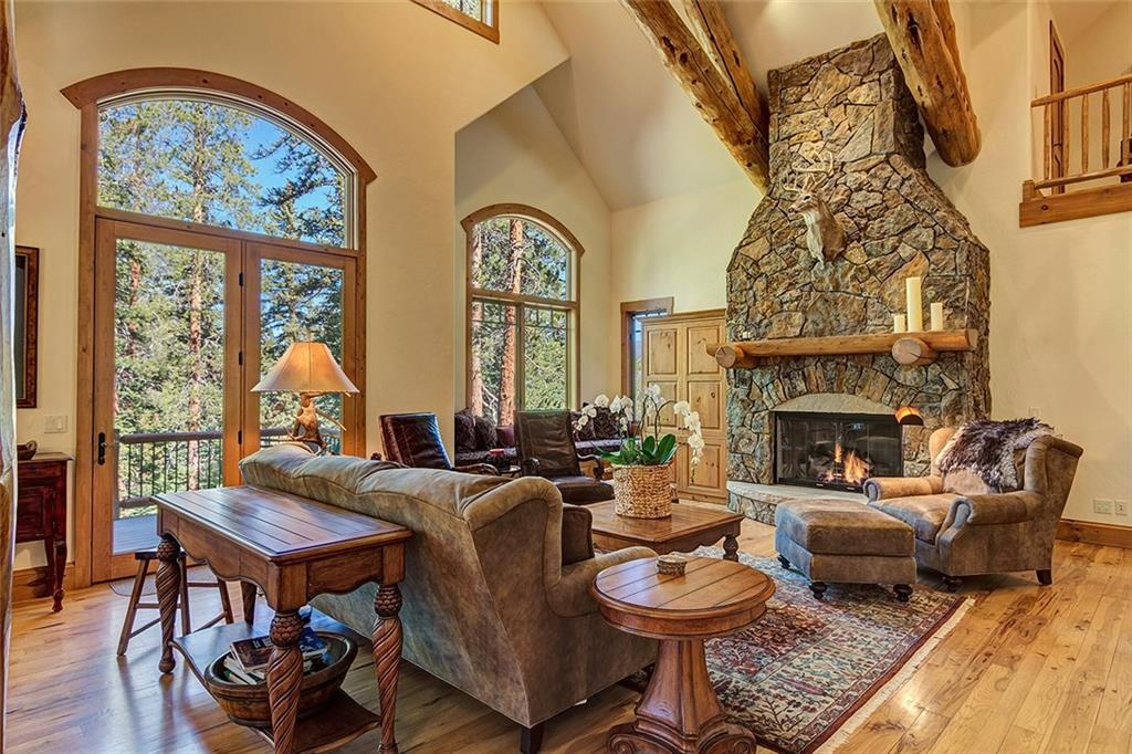 A floor-to-ceiling rock fireplace for you to enjoy.