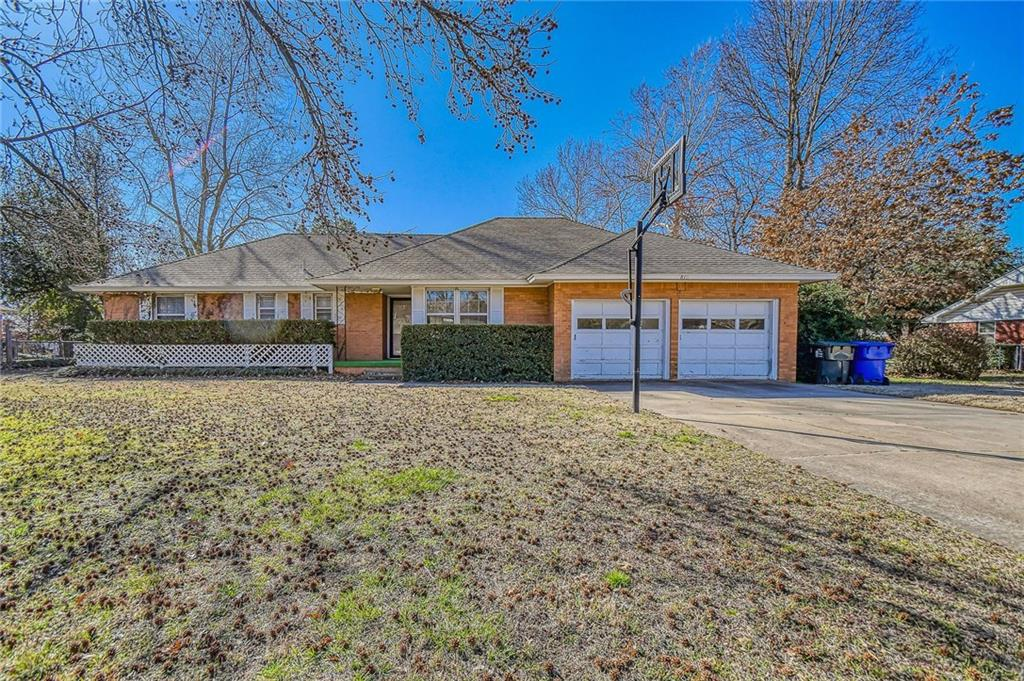 You can walk or ride bikes to OU campus.  Just a few blocks to OU Law School.  Great for investment, OU student or faculty, family or anyone wanting close to campus.  Needs some updates..paint and flooring but will make a great home.  Hardwood flooring under the living area carpet.(may be in bedrooms also).  Newer double ovens and large lot.  Home to be sold as is.