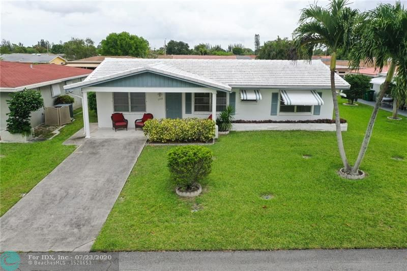 This perfect and cozy home is in the Mainlands in Tamarac. This home offers a BRAND new a/c unit, newer roof, 2 oversized bedrooms, 2 full bathrooms, a very spacious family room and Florida room with a peaceful water view. Home is priced to sell quick! Don't miss it.