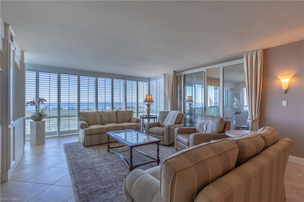 Floor to ceiling glass windows offer unparalleled views of the Gulf of Mexico and Clam Bay from this 14th story three bedroom plus den, two and a half bath corner residence in the Claridge at Pelican Bay. This spacious and tastefully decorated end unit features marble floors, an updated kitchen, crown molding, and plantation shutters on the numerous windows. Open the glass sliders in the Florida room and enjoy the ocean breeze while admiring Naples award winning sunsets. The Claridge offers top notch amenities including a large heated pool and spa, updated barbecue grill stations, two guest suites and direct access to the Pelican Bay private beach clubs.