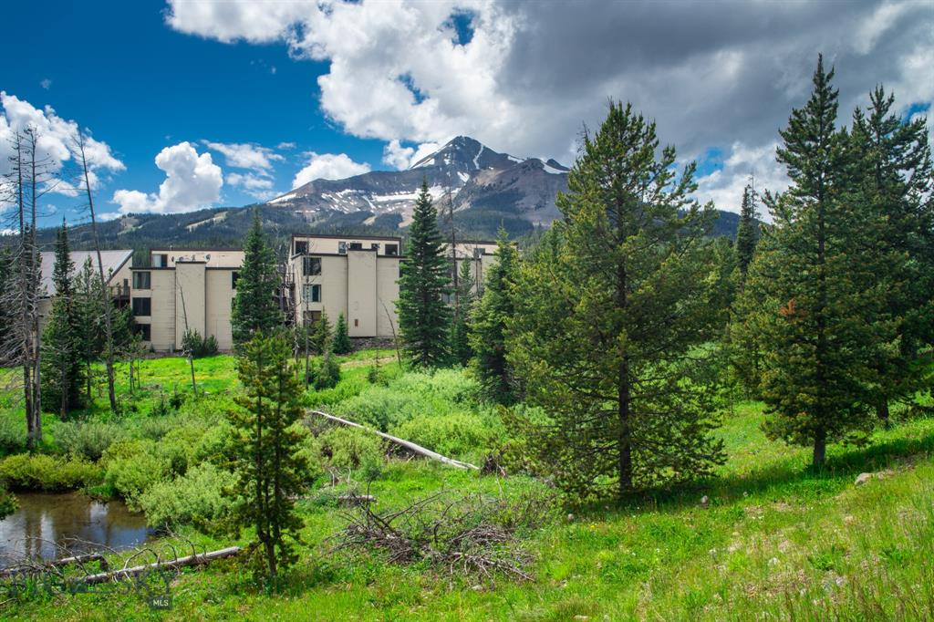 This third floor, studio unit is perfect for active, outdoor adventurists. Sold partially furnished, this property is approved for long term rentals.  Close proximity to Big Sky Resort, which offers skiing, mountain biking, hiking, ziplining, restaurants, shopping and more. Whether you decide to rent long term, short term or use it yourself, this floor plan is a great use of space.  Rare opportunity to own next to world class skiing.