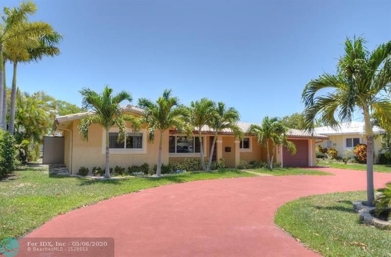 Marble flooring throughout,impact windows,remodeled kitchen & baths. Very clean,pool,only a few houses from Intracoastal,southern exposure-plumbing and electric upgraded.Top of the line everything. Separate 3 rd bedroom with 1 car garage. Corina counter tops with SS appliances.