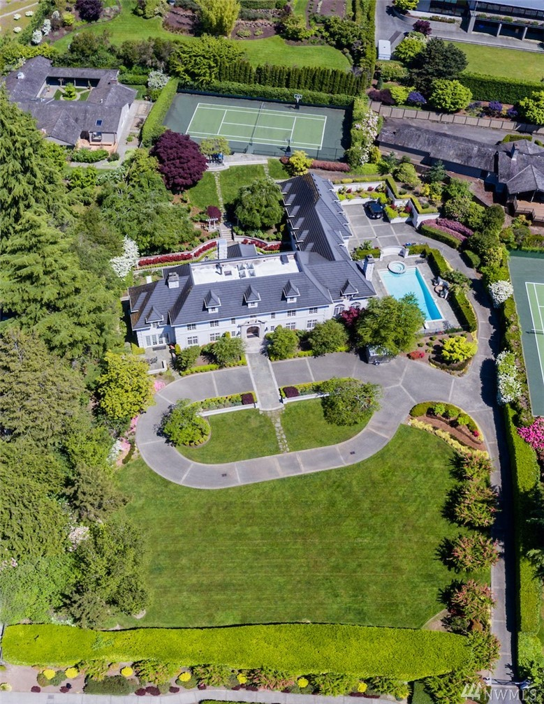 The Mansion on Clyde Hill. Sited on an expansive 1 1/2 acres of private grounds, overlooking the Seattle skyline, Lake Washington and the majestic Olympic Mountains. Known as one of the great estates in the Northwest, the 7,700+ sq ft residence offers the best in formal & casual entertaining. A juxtaposition of European styling with modern sophistication. Unmatched attention to detail and exceptional finishes & features. Tennis court, pool, elegant gardens. Remarkable. Rare. There is no other.