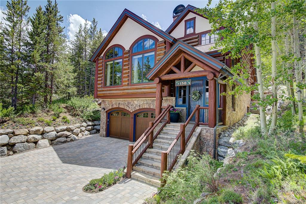 This jaw-dropping custom home was designed by top local architect, Janet Sutterley, and was built by renowned local builder, Infinite Scope. It offers 5 beds, 6 baths and has 4475 sq.ft. on 3 levels. Enjoy amazing views of the Keystone River Golf Course and surrounding mountains as well as bask in the ambiance of numerous top-line finishes including 6 fireplaces, natural sandstone flooring, as well as full-log columns, trusses and accents. The heated pavers on the driveway and patio are a bonus.