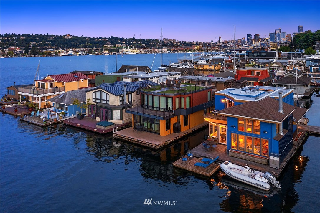 Revel in the ambiance of Lake Union living on this design-centric floating home once featured on HGTV & NYT. Owned outer slip with breathtaking views of Gasworks & Downtown due to no neighboring home to the North or South. Unforgettable 360° rooftop deck views of July fireworks, seaplanes & sailboat races. Walls of windows lead to 3 view decks, artfully framing the gentle but action-packed waters of LU. Private open-format living offers 2-story ceilings, sauna, 5-piece bath, Downtown view office, grand walk-in closet & gourmet kitchen. Hand-carved Cherry cabinetry throughout by former editor of Fine Woodworking Mag. Rare accessory raft, boat mooring & city parking for 3. Gated community & exceptional dock stewardship.