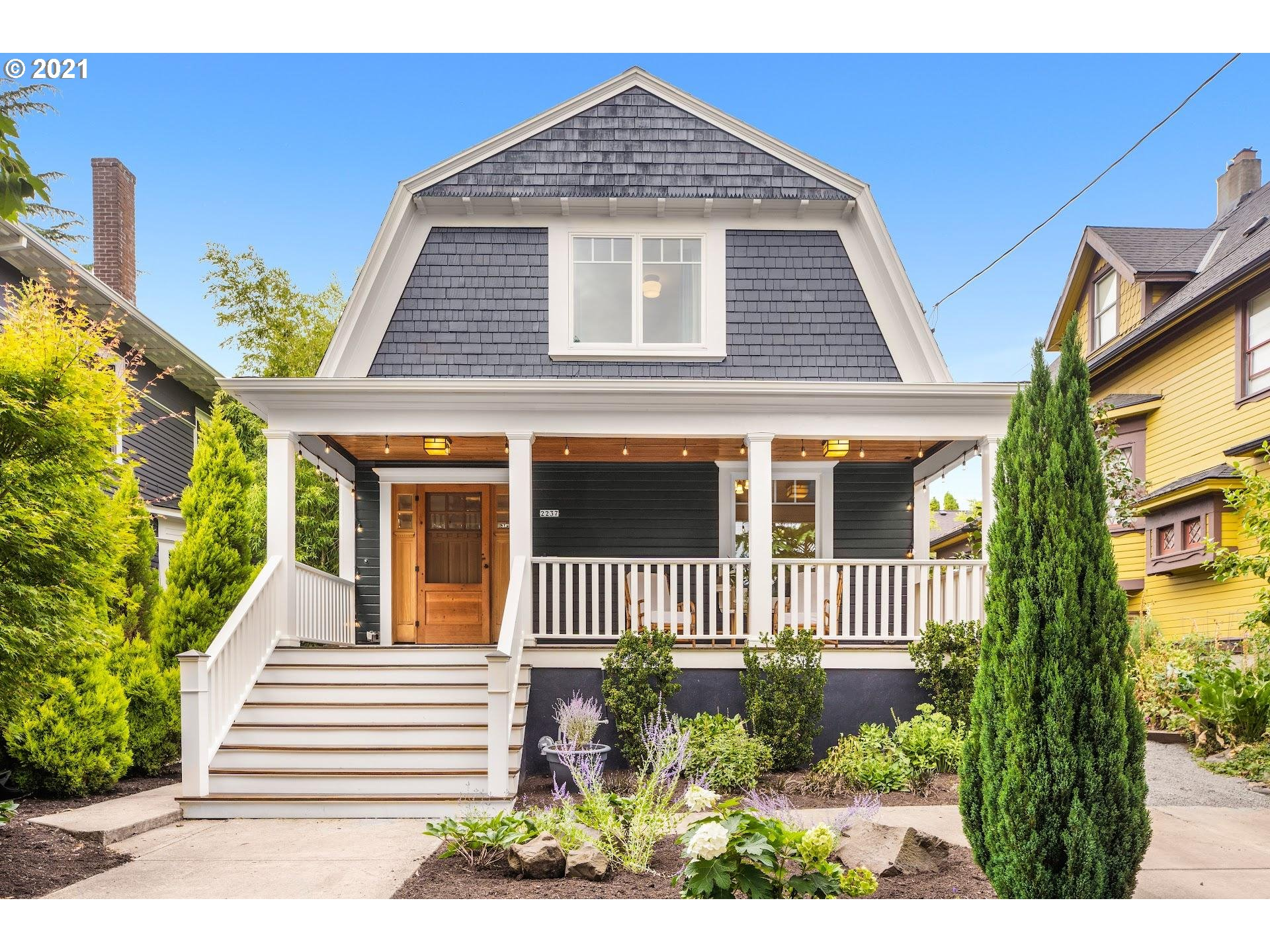 Prime location on coveted street in Sullivans Gulch. A block brimming w/ charm, lush gardens, amazing neighbors and incredible walkability! This light, bright, uber-charming Dutch Colonial Farmhouse boasts updated systems, too: plumbing, electrical, windows, insulation, even duct work! Tall ceilings.Awesome layout. Open main floor. 3 bds up + 2 more down in finished basement. Enviable proximity (< 1 mile) to the countless restaurants, shops, bars of NE 28th, NE Broadway, SE Pdx, downtown, Pearl! [Home Energy Score = 3. HES Report at https://rpt.greenbuildingregistry.com/hes/OR10193484]