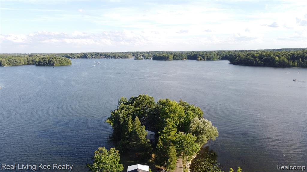 Location, Location, Location!  An amazing chance to own 2 lakefront homes next door for the one price of $850k.  Situated on a private road on the end of peninsula, 500 and 512 Deerpointe have the best views on All Sports Lakeville Lake.  With a combined 432 feet of water frontage, you'll have rare access to both sunrises, sunsets, and everything in between.  500 Deerpointe is a Bi-level,  4 bedrooms, 2 bathrooms, 2,377 sq ft.  Floor to ceiling windows in living room facing south.  Solid walkout basement.  Grandfathered boathouse.  512 Deerpoint is a colonial, 3 bedrooms, 2 bathrooms, 2,228 sq ft.  Cantilever dock.  Diving board.  Homes need TLC.  Remodel or build.  Massive potential with endless possibilites.  Value is in the land.  Hidden gem!  Don't miss out! (500 Deerpointe Tax ID# 0522176009) (512 Deerpointe Tax ID# 0522176006)