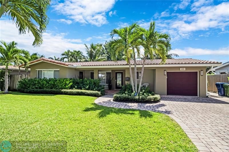 Wonderful Mid Century home in HOT Wilton Manors. Perfect layout w/ 2 full master suites on each side of the home, large open living area with fireplace, Florida room, beautiful terrazzo floors, and large bright picture window / sliders & French doors to the back yard.  Renovated kitchen w/ granite & stainless appliances.  Private resort style back yard with heated pool, dining area, shower, extensive outdoor lighting and professionally planned landscaping. All this... plus that rare hard to find garage the hasn't been converted! Extremely successful vacation rental with income history.  Call to view this property today!