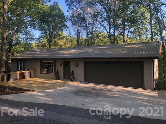Less than 1 mile to downtown Tryon, this newly renovated 3 bedroom, 2 1/2 bath, 2400 sq ft, open floor plan, ranch is just what you've been looking for. Home has new HVAC, all new plumbing, new electrical, all new appliances. You'll enjoy plenty of outdoor living space with beautiful mountain and valley views, a two car garage and multiple decks and porches.