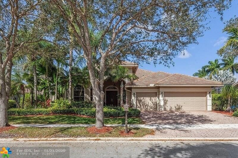 Located in one of the most desirable guard gated community in Weston: The Landings. Nestled on an oversized lot with lake views. Screened in freestyle swimming pool. Do you know that homey feeling when you enter through the door of a house and you realize that home is for you! Well this one is waiting for you. Tastefully updated with marble, wood, crown moldings, etc... remodeled kitchen, bathrooms top to bottom good taste. 4 bedrooms + office, 4 bathrooms. Very easy to show, so don't wait, contact me today for a private showing and see for yourself .