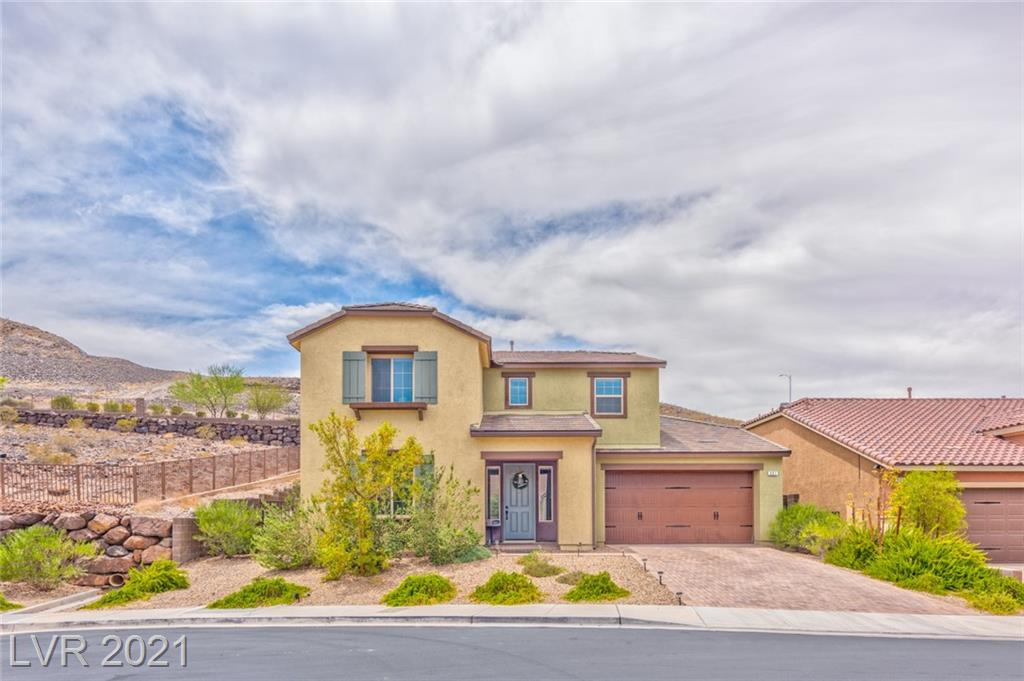 """A Rare Opportunity to own a NextGen, Corner Cul-de-sac Home w Pool, Mountain Backdrop & No Rear Neighbors!! Located in a Private Gated Henderson Subdivision. The NextGen Suite Features Interior & Exterior Access, Large Bedroom, Bathroom, Separate Living Room, Kitchenette & Separate W&D Hookups. Main Home has Upgraded Kitchen with SS Appliances, WI Pantry, Andover Maple Cabinets, Granite Counter Tops w Custom Backsplash, Island w Breakfast Bar that overlooks the Great-room. Tile """"Wood Like Flooring"""" Graces the Lower Level. Back Yard has been professional Landscaped and Features a Sparkling Pool, Paver patio Side Yard & Walkway. Strip and Mountain Views from the Large Upstairs Loft. The Upstairs Laundry Room was Upgraded to include Walkthrough from the Primary Bedroom Closet. Enjoy Serenity on the Large Balcony off the Primary Bedroom that overlooks the Serene Mountain Backdrop. 3 Car Tandem Garage w Paver Brick Driveway. Close Access to HWY 215 & Minutes from the Henderson District GVR"""