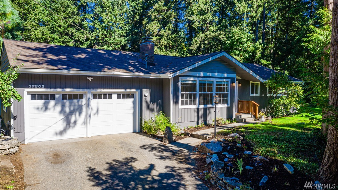 Splendid Completely Remodeled Modern Rambler on Large Corner Lot. Deer visit to eat the apples and plums. This great place has 3 bedrooms, 1.75 baths, move in ready. You'll love the wood floors, sweet new kitchen with quartz counters and modern backsplash. New bathrooms, electrical, plumbing, water heater, brand new sewer line, insulation, new furnace with heat pump, AC baby! Large living room & master bedroom. Home is deeded into Lake Forest Park Civic Club, wonderful beach and boating access.